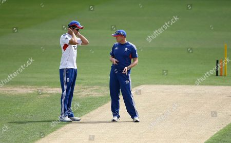 England's cricket captain Alastair Cook, left talks to team coach Andy Flower during a nets session for the 5th Ashes cricket Test against Australia, at the Oval cricket ground in London, . The 5th test starts Wednesday at the Oval in London, England have already won the series and retained the Ashes