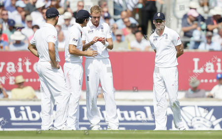 England's captain Alastair Cook, second right and teammate Chris Broad look at the condition of the ball as they play Australia during play on the first day of the fifth Ashes cricket Test at the Oval cricket ground in London