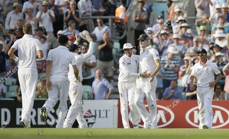England's Kevin Pietersen, second right, is congratulated by teammates after taking a catch to dismiss Australia's Shane Watson, unseen, off the bowling of England's Chris Broad for 176 runs during play on the first day of the fifth Ashes cricket Test at the Oval cricket ground in London