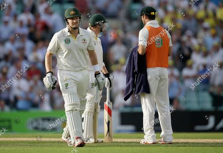 Australia'sShane Watson walks off the pitch after being given out caught by England's Kevin Pietersen off the bowling of Chris Broad for 176 runs during play on the first day of the fifth Ashes cricket Test at the Oval cricket ground in London