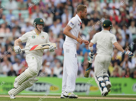 Australia's Steven Smith, left, takes a single run past England's bowler Chris Broad during play on the second day of the fifth Ashes cricket Test at the Oval cricket ground in London