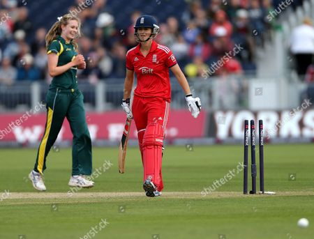 England's Charlotte Edwards walks from the pitch after being bowled out by Australia's Holly Ferling during their Twenty20 cricket match at the Riverside cricket ground, Chester-le-Street, England