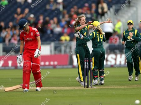 Australia's Holly Ferling, center, celebrates after bowling out England's Charlotte Edwards during their Twenty20 cricket match at the Riverside cricket ground, Chester-le-Street, England