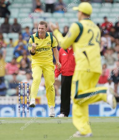 Australia's Xavier Doherty, left, celebrates after taking the wicket of Sri Lanka's Tilakaratne Dilshan caught by teammate Shane Watson, unseen, during their ICC Champions Trophy cricket match at the Oval cricket ground in London