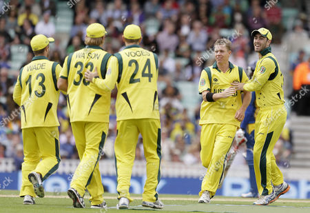 Stock Picture of Australia's Xavier Doherty, second right, celebrates taking the wicket of Sri Lanka's Tilakaratne Dilshan caught by teammate Shane Watson, second left, during their ICC Champions Trophy cricket match at the Oval cricket ground in London