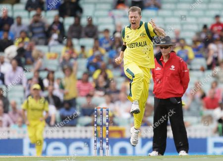 Australia's Xavier Doherty celebrates taking the wicket of Sri Lanka's Tilakaratne Dilshan caught by teammate Shane Watson, unseen, during their ICC Champions Trophy cricket match at the Oval cricket ground in London