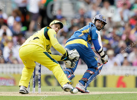 Sri Lanka's batsman Lahiru Thirimanne, right, plays a shot past Australia's wicketkeeper Matthew Wade off the bowling of Xavier Doherty during their ICC Champions Trophy cricket match at the Oval cricket ground in London