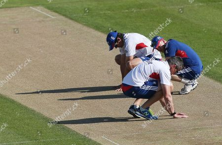 England's coach Andy Flower, right, captain Alastair Cook, back left, and Ashley Giles, front, inspect the wicket ahead of a nets session one day before the start of the fourth Ashes series cricket match against Australia at the Riverside cricket ground in Chester-le-Street, England