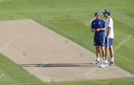 England's coach Andy Flower, left, and captain Alastair Cook, right, inspect the wicket ahead of a nets session one day before the start of the fourth Ashes series cricket match against Australia at the Riverside cricket ground, Chester-le-Street, England