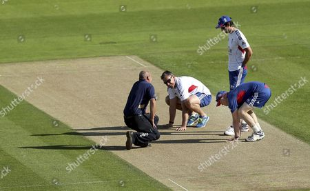 England's coach Andy Flower, right, captain Alastair Cook, second right, Ashley Giles, center, and the groundsman, left, inspect the wicket ahead of a nets session one day before the start of the fourth Ashes series cricket match against Australia at the Riverside cricket ground, Chester-le-Street, England