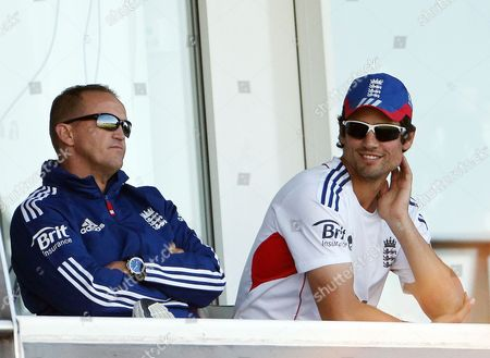 England's coach Andy Flower, left, and captain Alastair Cook watch from the stand during the first day of the fourth Ashes series cricket match against Australia at the Riverside cricket ground, Chester-le-Street, England