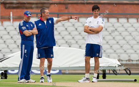 Alastair Cook, Graham Gooch, Andy Flower England's captain Alastair Cook, right, stands with batting coach Graham Gooch and coach Andy Flower, left, before a nets session two days before the start of the third Ashes series cricket match against Australia at Old Trafford cricket ground, Manchester, England