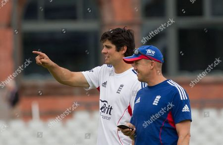 Alastair Cook, Andy Flower England's captain Alastair Cook, centre, speaks to coach Andy Flower before a nets session two days before the start of the third Ashes series cricket match against Australia at Old Trafford cricket ground, Manchester, England