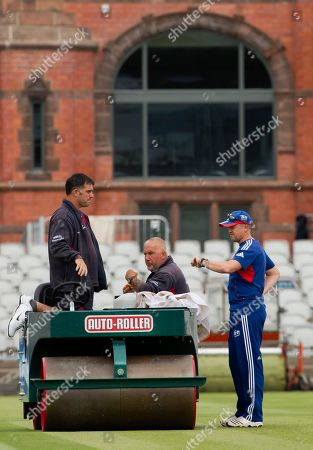 Andy Flower England's coach Andy Flower, right, speaks to grounds staff before a nets session two days before the start of the third Ashes series cricket match against Australia at Old Trafford cricket ground, Manchester, England