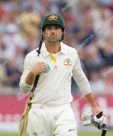 Australia's Ed Cowan walks from the pitch after losing his wicket for 0 off the bowling of England's Steven Finn on the first day of the opening Ashes series cricket match at Trent Bridge cricket ground, Nottingham, England