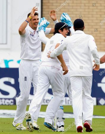 England Steven Finn, left, celebrates with teammates including captain Alastair Cook, centre, after taking the wicket of Australia's Ed Cowan for 0 caught by Graeme Swann on the first day of the opening Ashes series cricket match at Trent Bridge cricket ground, Nottingham, England