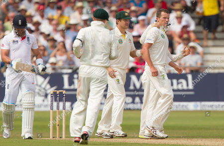 Australia's Peter Siddle, right, celebrates with teammates after taking the wicket of England's Matt Prior, left, for 31 caught by Ed Cowan on the third day of the opening Ashes series cricket match at Trent Bridge cricket ground, Nottingham, England