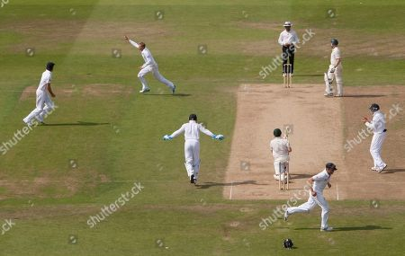 England's Joe Root, upper centre left, celebrates after taking the wicket of Australia's Ed Cowan, lower centre right, caught by Jonathan Trott for 14 on the fourth day of the opening Ashes series cricket match at Trent Bridge cricket ground, Nottingham, England