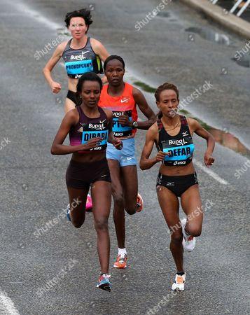 Ethiopia's Meseret Defar, right, and Ethiopia's Tirunesh Dibaba, left, compete during the Great North Run half-marathon, Newcastle, England