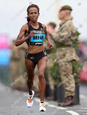 Ethiopia's Meseret Defar in action during the Great North Run, in Newcastle, England, . Kenya's Priscah Jeptoo, won the race ahead of Ethiopia's Meseret Defar, and third placed Ethiopian Tirunesh Dibaba