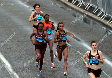 Stock Picture of Ethiopia's Meseret Defar, center right, and Ethiopia's Tirunesh Dibaba, left, compete during the Great North Run half-marathon, Newcastle, England