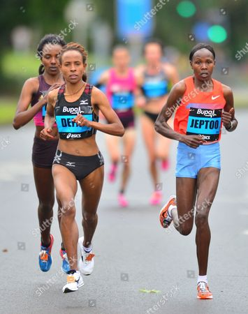 Kenya's Priscah Jeptoo, right, and Ethiopia's Meseret Defar, left, contest for the honors during the Great North Run, Newcastle, England, . Kenya's Jeptoo, won the half marathon event ahead of second placed Ethiopian Defar, and third placed Ethiopian Tirunesh Dibaba