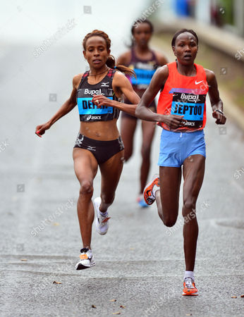 Kenya's Priscah Jeptoo, right, and Ethiopia's Meseret Defar, left, during the Great North Run in Newcastle, England, . Kenya's Jeptoo, won the half marathon event ahead of second placed Ethiopian Defar, and third placed Ethiopian Tirunesh Dibaba