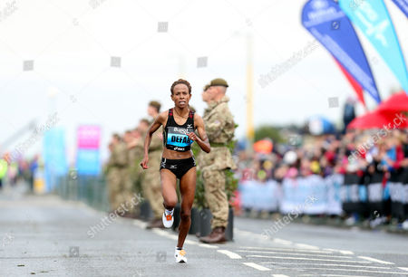 Ethiopia's Meseret Defar, during the Great North Run, in Newcastle, England, . Kenya's Priscah Jeptoo, won the race ahead of Ethiopia's Meseret Defar, and third placed Ethiopian Tirunesh Dibaba