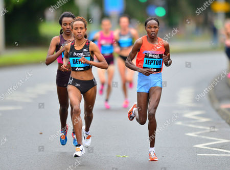 Kenya's Priscah Jeptoo, right, and Ethiopia's Meseret Defar, left, during the Great North Run, in Newcastle, England, . Kenya's Jeptoo, won the half marathon event ahead of second placed Ethiopian Defar, and third placed Ethiopian Tirunesh Dibaba