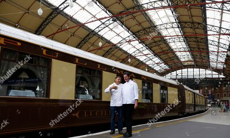Stock Image of Chef and restaurateur Raymond Blanc, left, greets Robbie Gleeson Head Chef for the day trains by The British Pullman train at Victoria Station in London, . The chef was launching a series of 'pop-up' dinners on board the iconic train that will be held throughout 2013 and 2014 hosted by renowned chefs