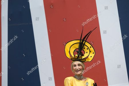Florence Claridge poses for the media in a yellow hat on the second day of the Royal Ascot horse race meeting in Ascot, England