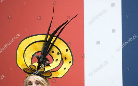 Stock Picture of Florence Claridge pose for the media in a yellow hat on the second day of the Royal Ascot horse race meeting in Ascot, England