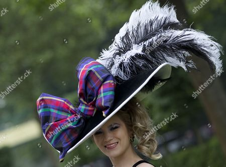 Mimi Theobald poses for the media with an ornate hat on the third day traditionally known as Ladies Day of the Royal Ascot horse race meeting in Ascot, England