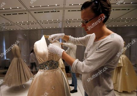 An employee fixes a dress worn by Princess Margaret to a film premier in London and to a dinner in Paris as a guest of Prince Paul of Yugoslavia in 1951, at the Fashion Rules exhibition at Kensington Palace in London. Opening on 4 July, a new glamorous exhibit at Kensington Palace showcases how the styles of three royal ladies; Queen Elizabeth II, her sometimes risque sister Margaret, and the glamorous Princess Diana, each reflected and influenced the trends of their fashion heyday