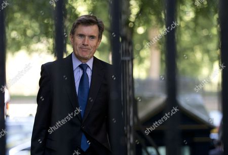 Britain's head of the Secret Intelligence Service, MI6, John Sawers arrives for a national security meeting on the situation in Syria at Downing Street in London, The heads of Britain's intelligence agencies will for the first time give public and televised testimony to U.K. lawmakers. Andrew Parker and John Sawers heads of Britain's domestic security agency MI5 and foreign spy service MI6 will appear along with Iain Lobban, director of electronic surveillance agency GCHQ to take questions from Parliament's Intelligence and Security Committee on Thursday, Nov. 7, 2013
