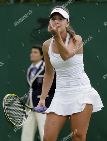 Michelle Larcher De Brito of Portugal gestures as she plays to Melanie Oudin of the United States during their Women's first round singles match at the All England Lawn Tennis Championships in Wimbledon, London