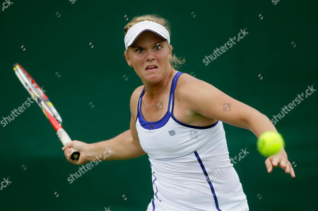 Melanie Oudin of the United States returns a shot to Michelle Larcher De Brito of Portugal during their Women's first round singles match at the All England Lawn Tennis Championships in Wimbledon, London