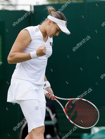 Nadia Petrova of Russia reacts after winning a point against Karolina Pliskova the Czech Republic during their Women's first round singles match at the All England Lawn Tennis Championships in Wimbledon, London