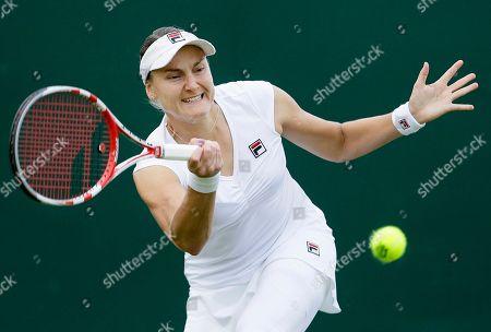 Nadia Petrova of Russia returns a shot to Karolina Pliskova the Czech Republic during their Women's first round singles match at the All England Lawn Tennis Championships in Wimbledon, London