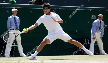 Hyeon Chung of South Korea plays a return to Gianluigi Quinzi of Italy during the Boys' singles final match at the All England Lawn Tennis Championships in Wimbledon, London