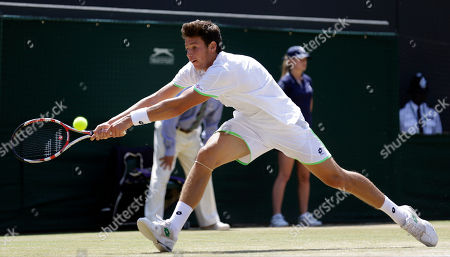Gianluigi Quinzi of Italy plays a shot to Hyeon Chung of South Korea during the Boys' singles final match at the All England Lawn Tennis Championships in Wimbledon, London