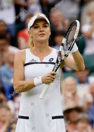 Agnieszka Radwanska of Poland celebrates after beating Mathilde Johansson of France during their Women's second round singles match at the All England Lawn Tennis Championships in Wimbledon, London
