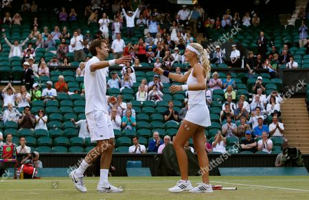 Daniel Nestor of Canada, left, and Kristina Mladenovic of France react as they win against Bruno Soares of Brazil and Lisa Raymond of the United States in the mixed doubles final match at the All England Lawn Tennis Championships in Wimbledon, London