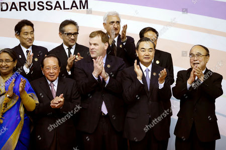Dipu Moni, Hor Namhong, John Baird, Wang Yi, Pak Ui Chun, Fumio Kishida, Marty Natalegawa, Salman Khurshid From front left to right: Bangladesh's Foreign Minister Dipu Moni, Cambodia's Foreign Minister Hor Namhong, Canada's Foreign Minister John Baird, China's Foreign Minister Wang Yi and North Korea's Foreign Minister Pak Ui Chun, and from rear left to right: Japan's Foreign Minister Fumio Kishida, Indonesia's Foreign Minister Marty Natalegawa, India's Foreign Minister Salman Khurshid during a group photo session for the 20th ASEAN Regional Forum Foreign Minister's Meeting in Bandar Seri Begawan, Brunei