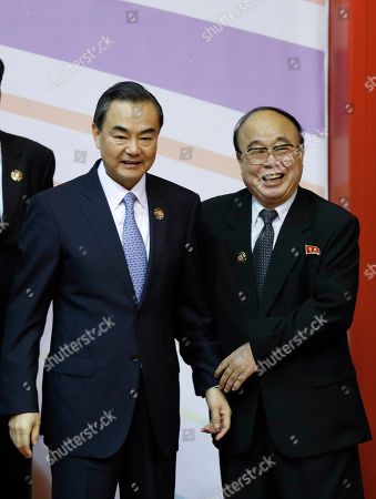 Wang Yi, Pak Ui Chun China's Foreign Minister Wang Yi, left, and North Korea's Foreign Minister Pak Ui Chun pose during a group photo session for ASEAN Regional Forum Foreign Ministers' Meeting in Bandar Seri Begawan, Brunei
