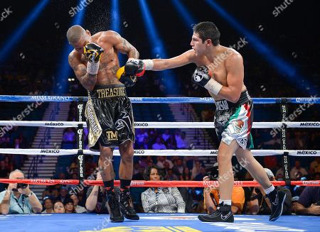 Pablo Cesar Cano, Ashley Theophane Pablo Cesar Cano, right, lands a punch against Ashley Theophane during a welterweight fight, in Las Vegas