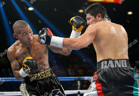 Pablo Cesar Cano, Ashley Theophane Ashley Theophane, left, lands a punch against Pablo Cesar Cano in the second round during a welterweight fight, in Las Vegas