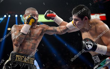 Pablo Cesar Cano, Ashley Theophane Ashley Theophane, left, lands a punch against Pablo Cesar Cano in the eighth round during a welterweight fight, in Las Vegas
