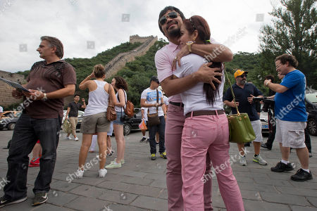 Manny Pacquiao, Jinkee Pacquiao Filipino boxer and Congressman Manny Pacquiao, center hugs his wife Jinkee along the Badaling section of the Great Wall of China in Beijing, China, . Pacquiao will fight with Brandon Rios of the United States in a welterweight bout at Venetian Macao in Nov. 24 in Macau