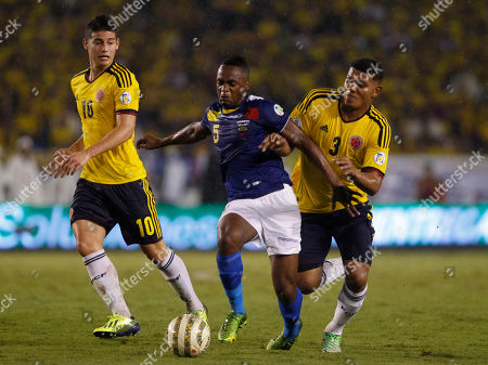 Stock Image of Alexander Meji, Alex Ibarra, James Rodriguez Ecuadors's Alex Ibarra, center, battles for the ball with Colombia's Alexander Mejia, right, and James Rodriguez, left, during a 2014 World Cup qualifying soccer match in Barranquilla, Colombia